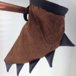 Soft fabric brown textured dinosaur tail